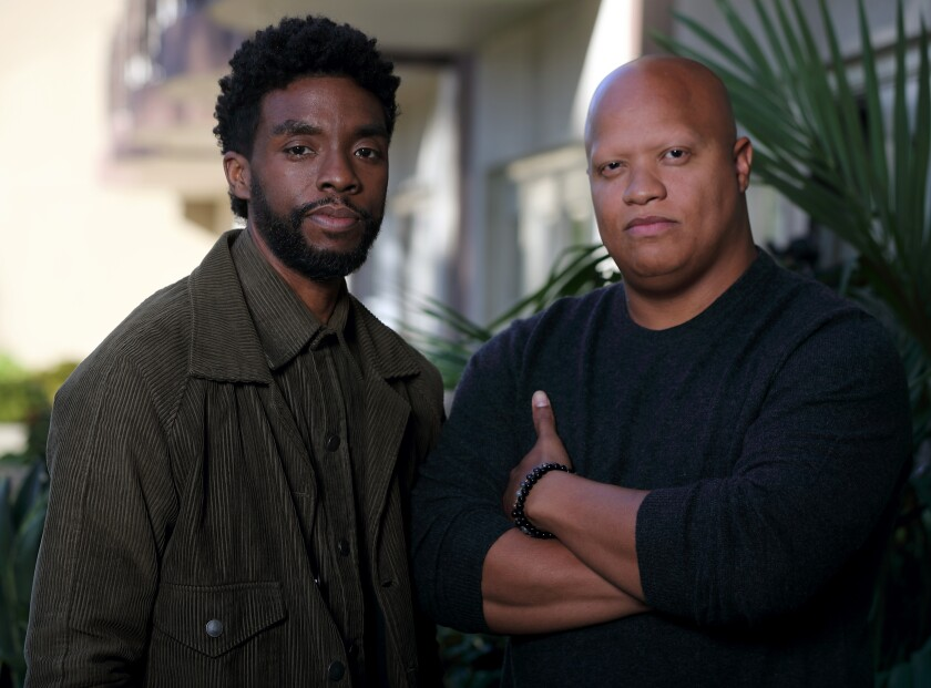 "Chadwick Boseman and Logan Coles produced ""21 Bridges."""