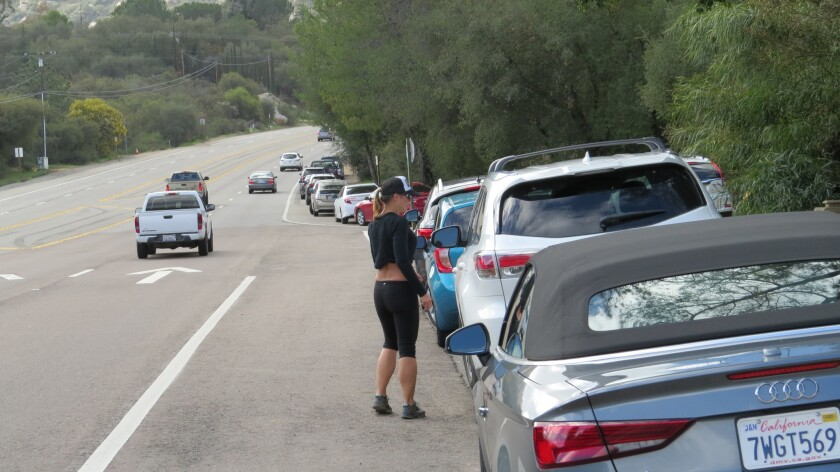 The county may buy land off state Route 67 in Ramona where it would build a parking lot where hikers visiting Potato Chip Rock and Mt. Woodson could park. For years now hikers have been parking along the western shoulder of the highway creating serious safety issues.