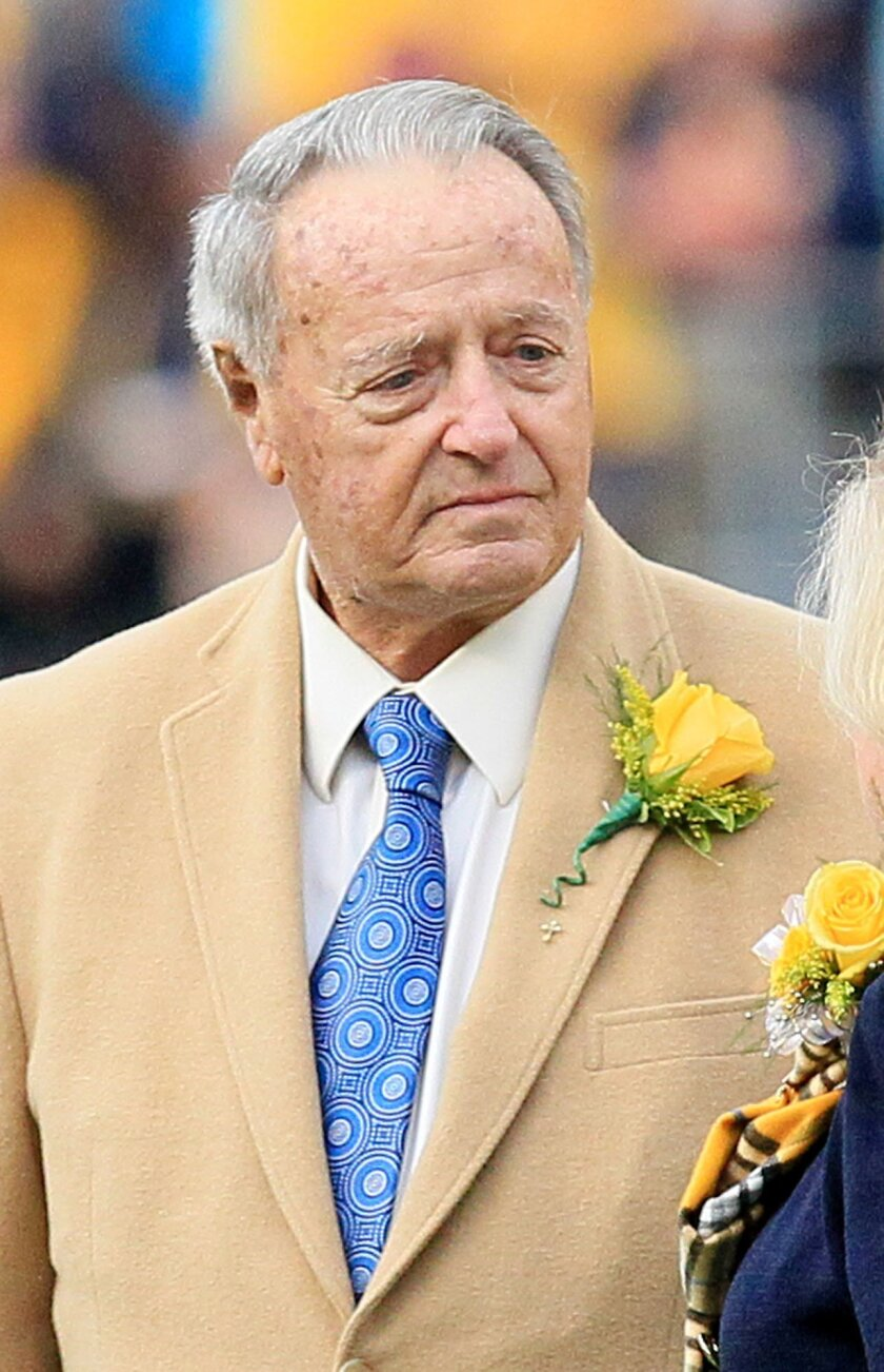 Former West Virginia head coach Bobby Bowden attends a ceremony where he was given the WVU Outstanding Alumni Award during halftime at an NCAA college football game against Kansas in Morgantown, W.Va., Saturday, Oct. 4, 2014. (AP Photo/Chris Jackson)