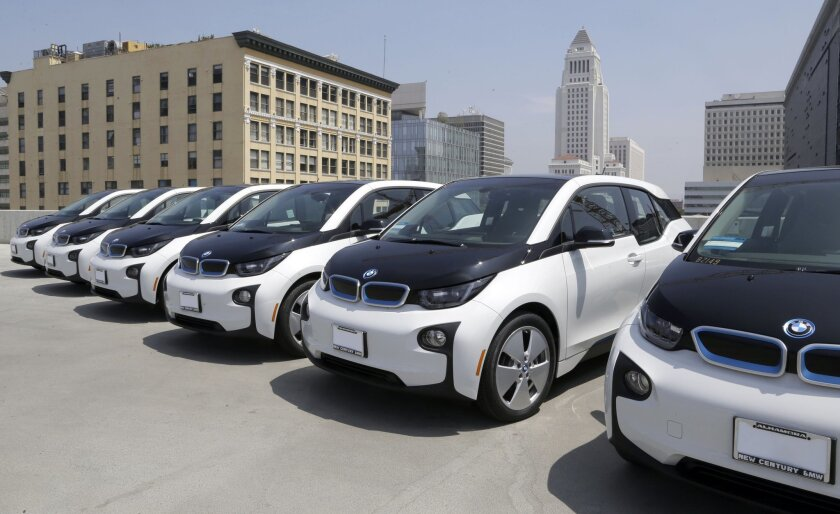 Electric cars are parked atop the Los Angeles Police Department parking lot, in Los Angeles on Wednesday, June 8, 2016. The Los Angeles Police Department has added 100 electric cars to its fleet as replacements for aging vehicles. The newly leased additions to the department motor pool announced We