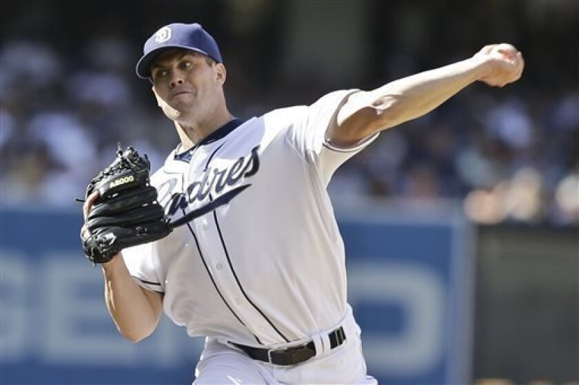 San Diego Padres starting pitcher Clayton Richard works the first inning against the Los Angeles Dodgers during a baseball game in San Diego, Tuesday, April 9, 2013. (AP Photo/Lenny Ignelzi)