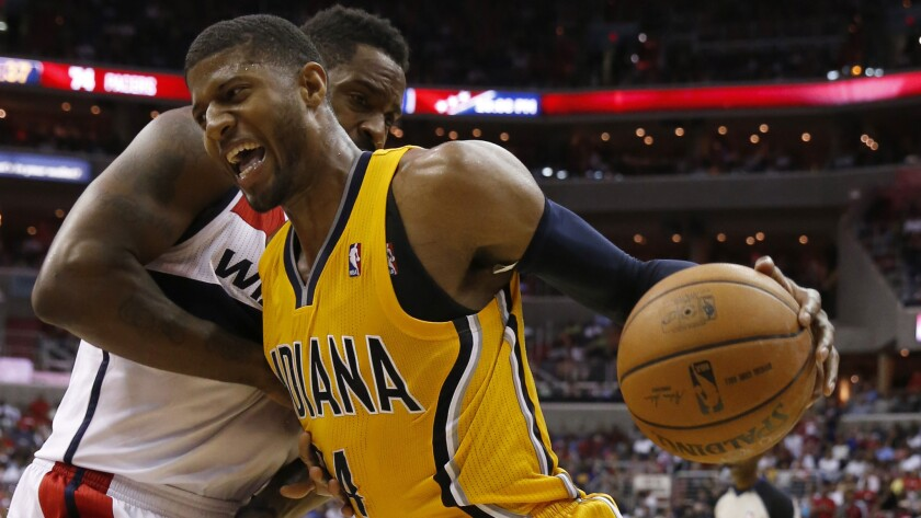 Indiana Pacers forward Paul George, right, drives past Washington Wizards forward Martell Webster during the Pacers' win in Game 4 of the Eastern Conference semifinals Sunday.