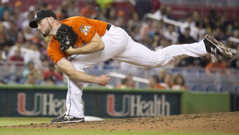 Marlins relief pitcher Carter Capps (22) throws to the San Francisco Giants during the eighth inning of a baseball game in Miami, Thursday, July 2, 2015.The Marlins won 5-4.