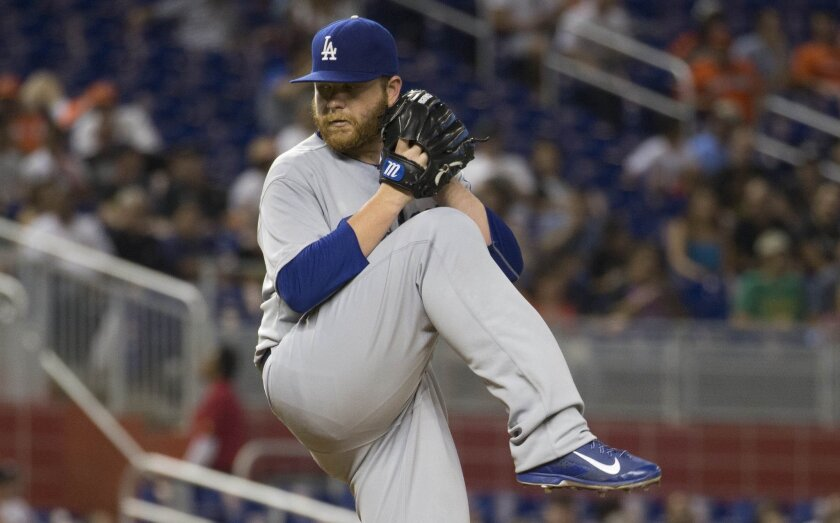 Los Angeles Dodgers starting pitcher Brett Anderson throws against the Miami Marlins during the first inning of a baseball game in Miami, Friday, June 26, 2015. (AP Photo/J Pat Carter)