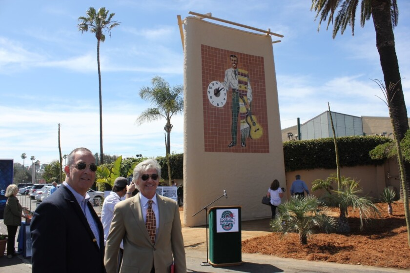 Russ Penniman, president of the 22nd District Agricultural Association board, and Tim Fennell, CEO and general manager of the Del Mar Fairgrounds at the upgraded Don Diego Clock Tower .