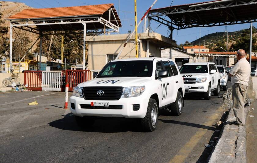A convoy of United Nations vehicles carrying a team of experts charged with overseeing the destruction of Syria's chemical weapons travels through Beirut before leaving for Damascus.