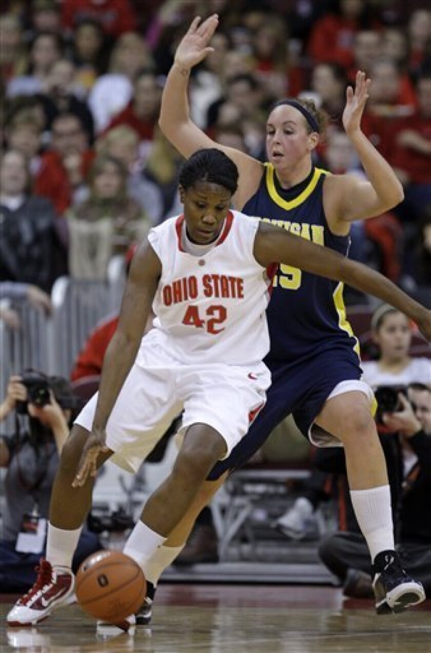 Ohio State's Jantel Lavender, left, posts up against Michigan's Krista Phillips during the first half of an NCAA college basketball game Sunday, Jan. 3, 2010, in Columbus, Ohio. (AP Photo/Jay LaPrete)