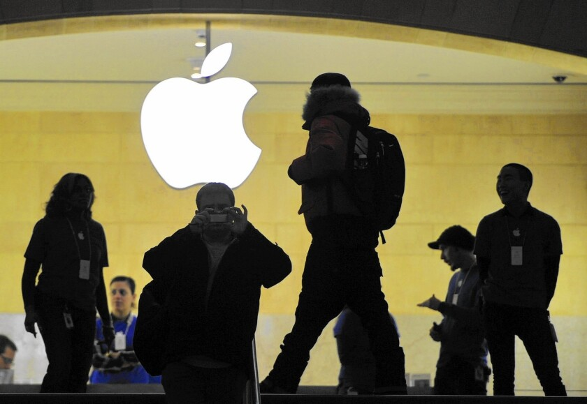 Apple chief Tim Cook said his company would fight a court order in the San Bernardino terror inquiry that asks the company for software to allow authorities to bypass the passcode on an encrypted phone. Above, an Apple store in New York.