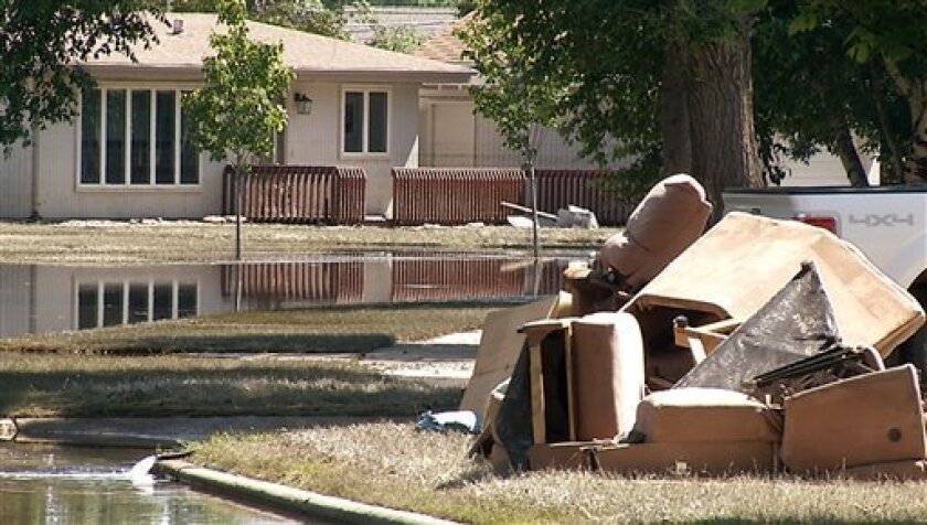 This frame grab from video provided by KXMC TV, Minot, show debris from flooded homes stacked on a curb Tuesday, July 5, 2011, in Minot, ND. Residents in some northeast parts of Minot were allowed to return their homes as the flooding Souris River continues to recede, said a spokesman in the North Dakota city. (AP Photo/KXMC TV)