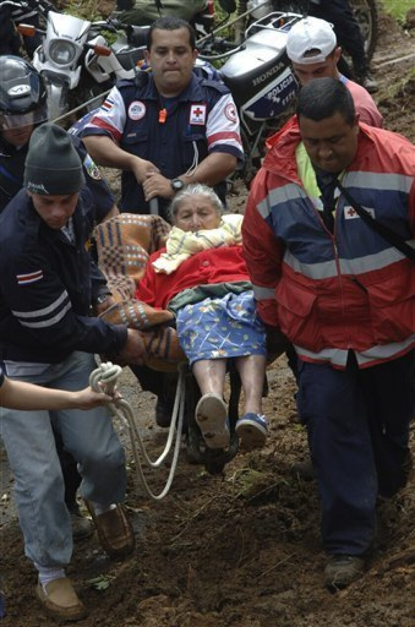 Emergency workers evacuate Antonia Prodo Villalobos, 83, after a 6.1-magnitude earthquake near La Cinchona, Costa Rica, Friday, Jan. 9, 2009. The Red Cross reported the death toll from Thursday's earthquake rose to at least 13. (AP Photo/La Nacion, Francisco Rodriguez)