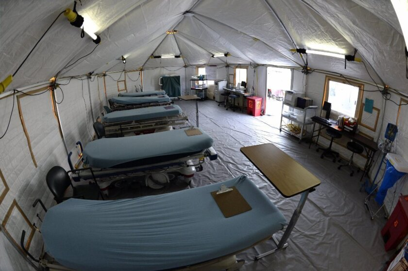 The Regional Medical Center of San Jose set up a 'flu tent' outside an emergency room to treat patients with flu-like symptoms in San Jose.