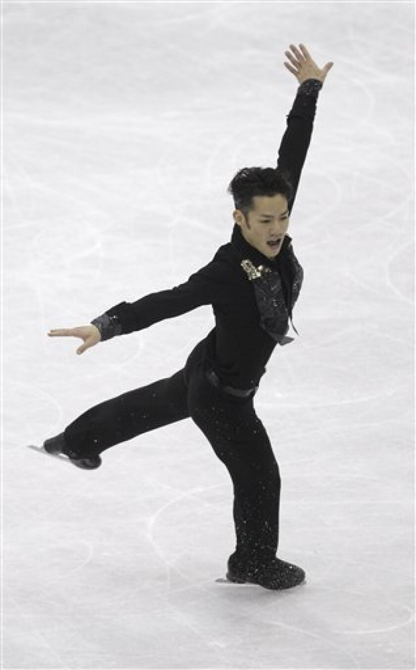 Daisuke Takahashi of Japan performs during his men free skating program at the 2012 World Figure skating Championships in Nice, southern France, Saturday, March 31, 2012. (AP Photo/Lionel Cironneau)