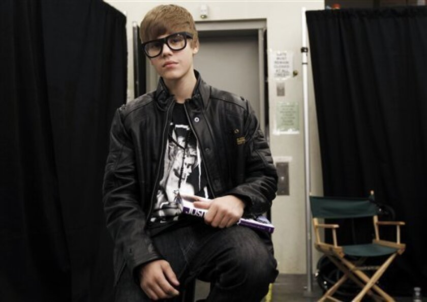 "Musician Justin Bieber poses for a portrait while promoting his new book, ""Justin Bieber: First Step 2 Forever"", in Los Angeles, Sunday, Oct. 31, 2010. (AP Photo/Matt Sayles)"