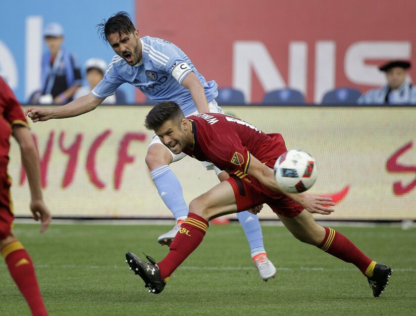 New York City FC forward David Villa, left, attempts to score against Real Salt Lake defender Chris Wingert during the first half of an MLS soccer game, Thursday, June 2, 2016, in New York. (AP Photo/Julie Jacobson)