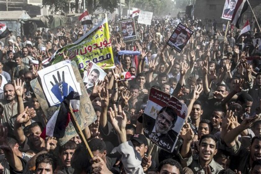 Supporters of Egypt's ousted President Mohammed Morsi chant slogans during a demonstration in Dalga Village, in upper Egypt, Friday, Aug. 30, 2013. Tens of thousands of protesters and Muslim Brotherhood supporters rallied Friday throughout Egypt against a military coup and a bloody security crackdo