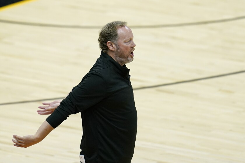 Milwaukee Bucks head coach Mike Budenholzer argues with officials during the second half of Game 1 of basketball's NBA Finals against the Phoenix Suns, Tuesday, July 6, 2021, in Phoenix. The Suns defeated the Bucks 118-105. (AP Photo/Ross D. Franklin)