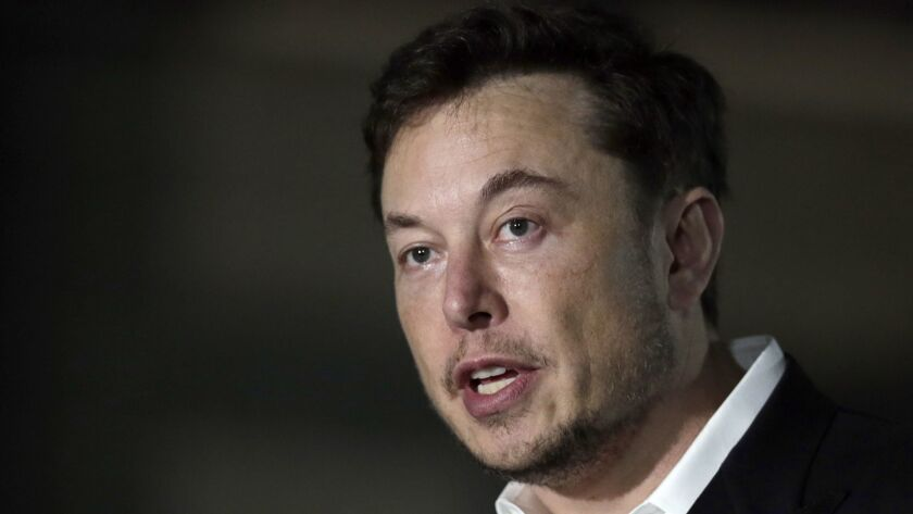 FILE - In a Thursday, June 14, 2018 file photo, Tesla CEO and founder of the Boring Company Elon Mus