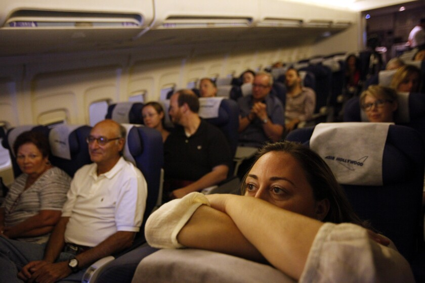 Students trying to overcome fear of flying experience simulated turbulence in a class in Pacoima. American Airlines and Alaska Airlines have been testing new sensors and software that relay information as a plane experiences turbulence.