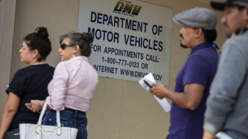 WINNETKA, CALIF. -- WEDNESDAY, SEPTEMBER 5, 2018: People wait in line for DMV service in Winnetka,