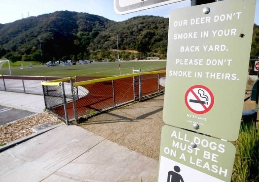"A no-smoking sign with a ""cheeky and humorous"" message greets visitors at the trailhead of the Catalina Verdugo Trail at the Glendale Sports Complex."