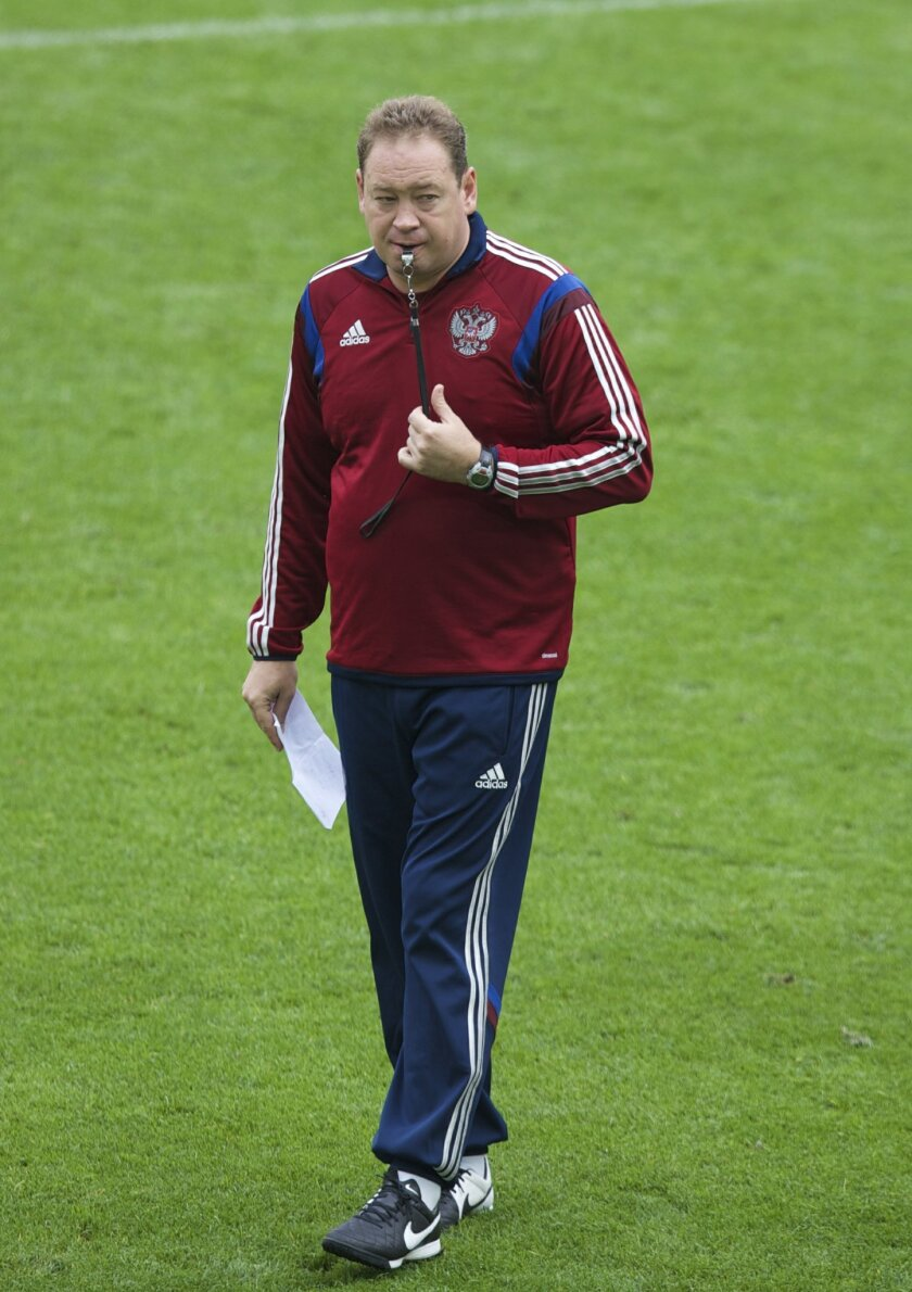 FILE - In this Friday, Sept. 4, 2015 filer, Russia's coach Leonid Slutsky watches his players during a training session in Moscow, Russia. (AP Photo/Pavel Golovkin, File)