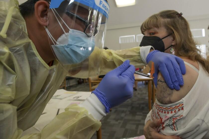 A woman receives a COVID-19 vaccine