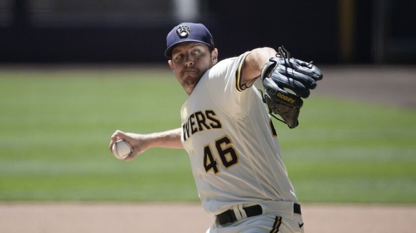 Milwaukee Brewers' Corey Knebel throws during a practice session.