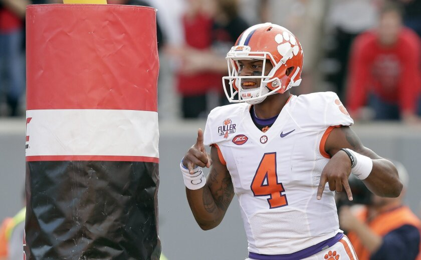 Clemson quarterback Deshaun Watson (4) reacts after his touchdown against North Carolina State during the first half of an NCAA college football game in Raleigh, N.C., Saturday, Oct. 31, 2015. (AP Photo/Gerry Broome)