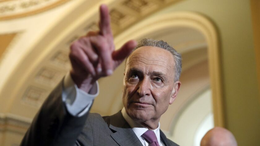 Senate Minority Leader Charles E. Schumer (D-N.Y.) points to a questioner during a media availability on Capitol Hill on Tuesday.