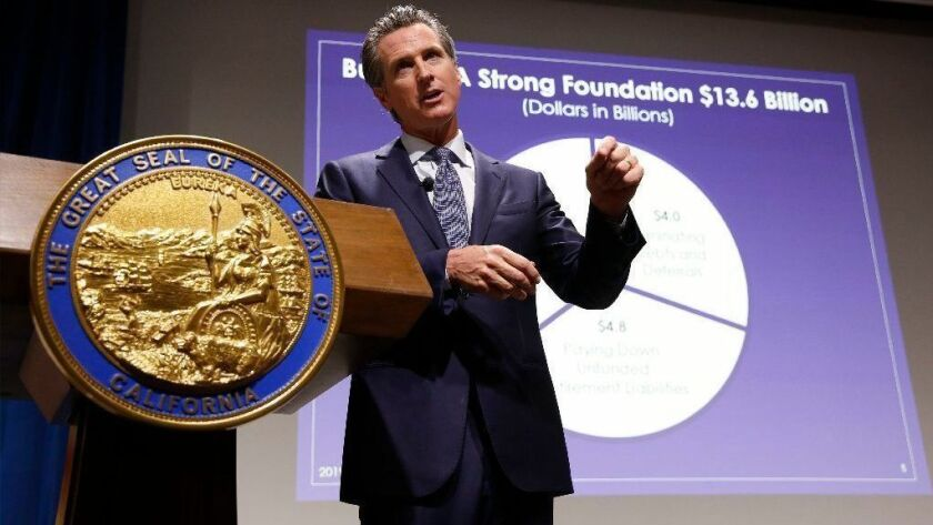 Gov. Gavin Newsom presents his first state budget during a news conference on Jan. 10 in Sacramento.
