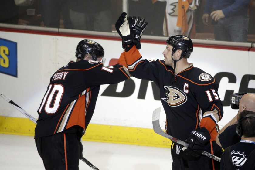 Ducks forward Corey Perry and center Ryan Getzlaf celebrate during a Ducks' playoff victory against the Flames.