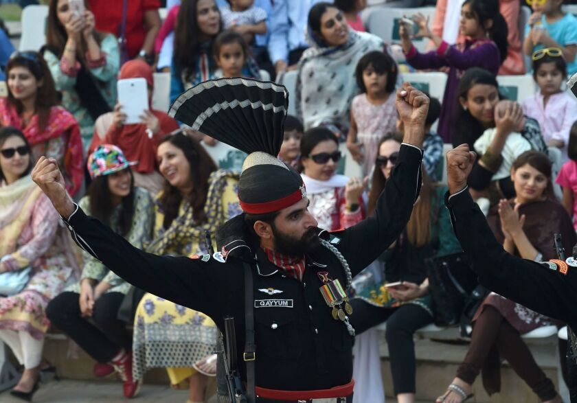A Pakistani Ranger raises his arms during the flag ceremony at the Indo-Pakistani border post of Wagah.