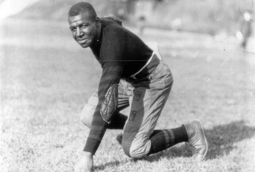 """Iowa football player Frederick """"Duke"""" Slater poses for a photo in 1921 Slater was the NFL's first African-American lineman, and often the only Black player on the field. After retiring, he broke down more racial barriers to become a judge in Chicago. (Chicago Sun-Times via AP)"""