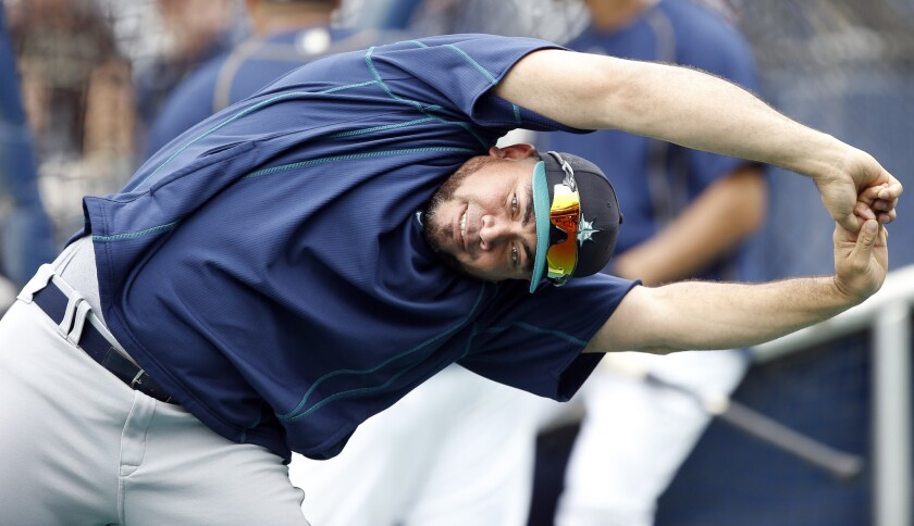 Mariners relief pitcher Joaquin Benoit stretches out before a baseball game against the San Diego Padres in San Diego, Wednesday, June 1, 2016.
