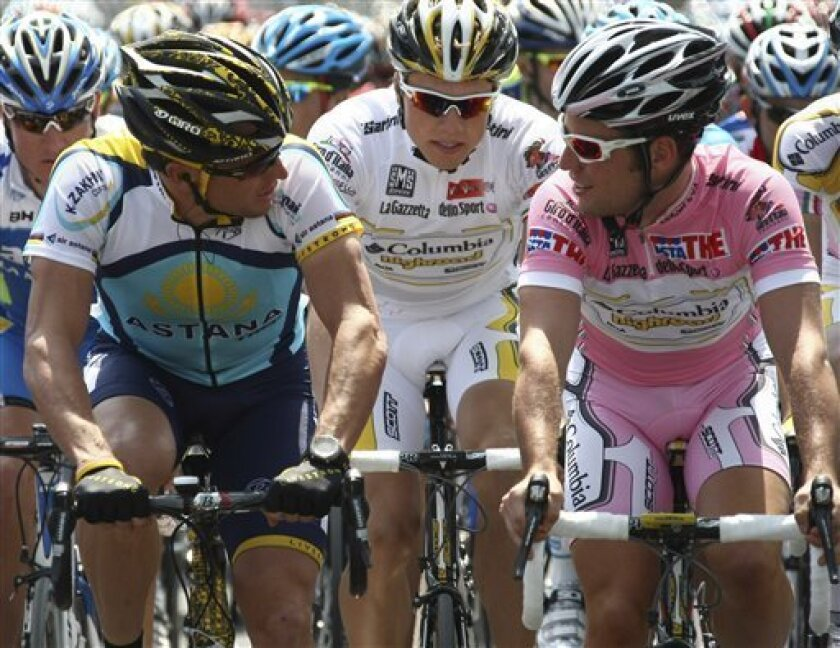 U.S. Lance Armstrong, left, talks with Britain's Mark Cavendish as they lead the pack of riders during the second stage of the Giro d'Italia, Tour of Italy cycling race, from Jesolo to Trieste, Sunday, May 10, 2009. (AP Photo/Alessandro Trovati)