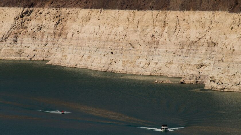 An image from July 2015 shows boaters in Lake Mead amid a giant bathtub ring of sediment that highlights the low water levels due to drought on the Colorado River.