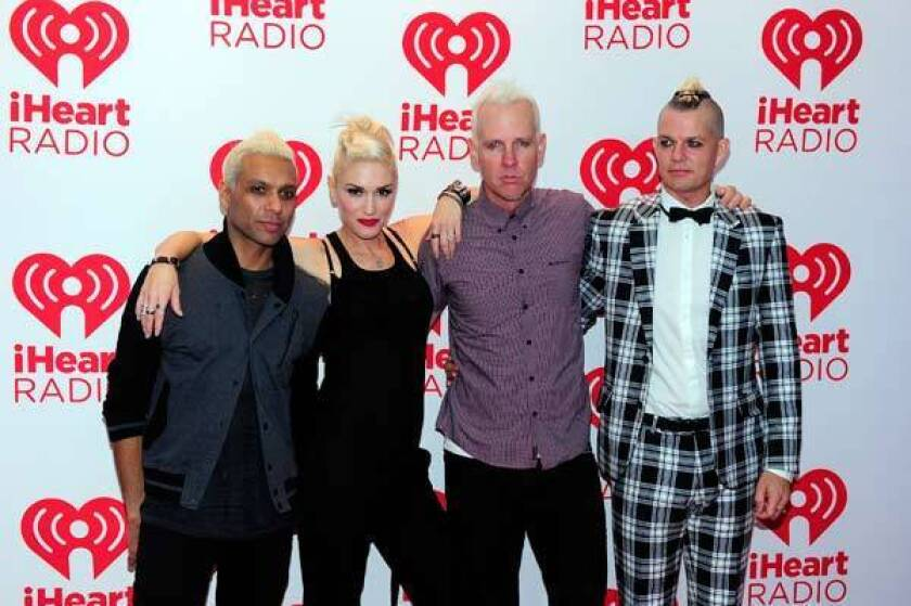 Bassist Tony Kanal, singer Gwen Stefani, guitarist Tom Dumont and drummer Adrian Young pose at iHeartRadio Music Festival.