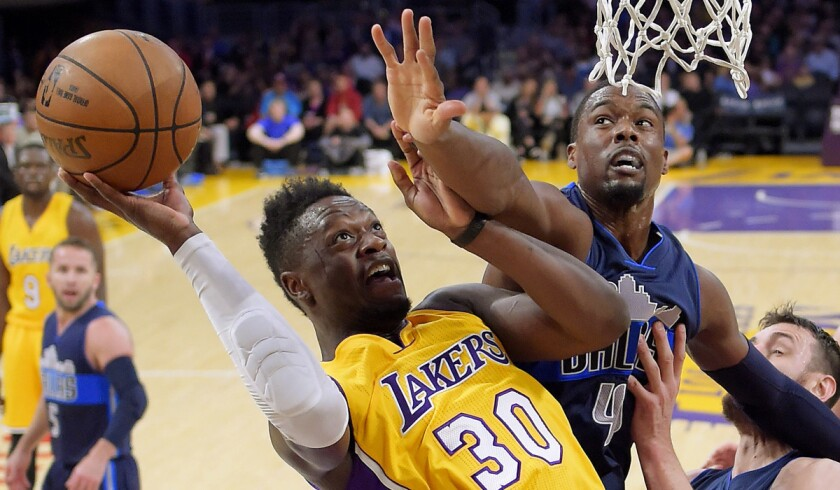 Lakers forward Julius Randle, left, shoots as Dallas Mavericks forward Harrison Barnes defends during the first half Tuesday.