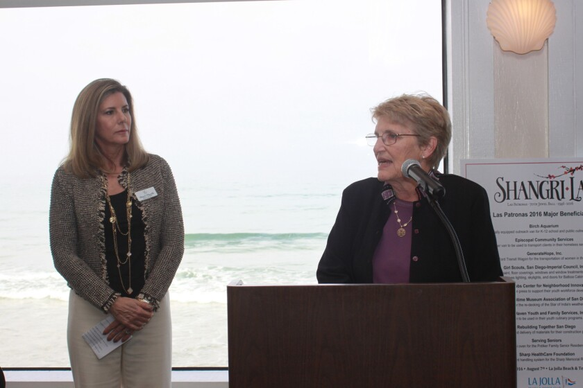 Sherry Macelli (left) presents the first Legacy Grant to Antonia Lawrence of the Big Sisters League of San Diego.