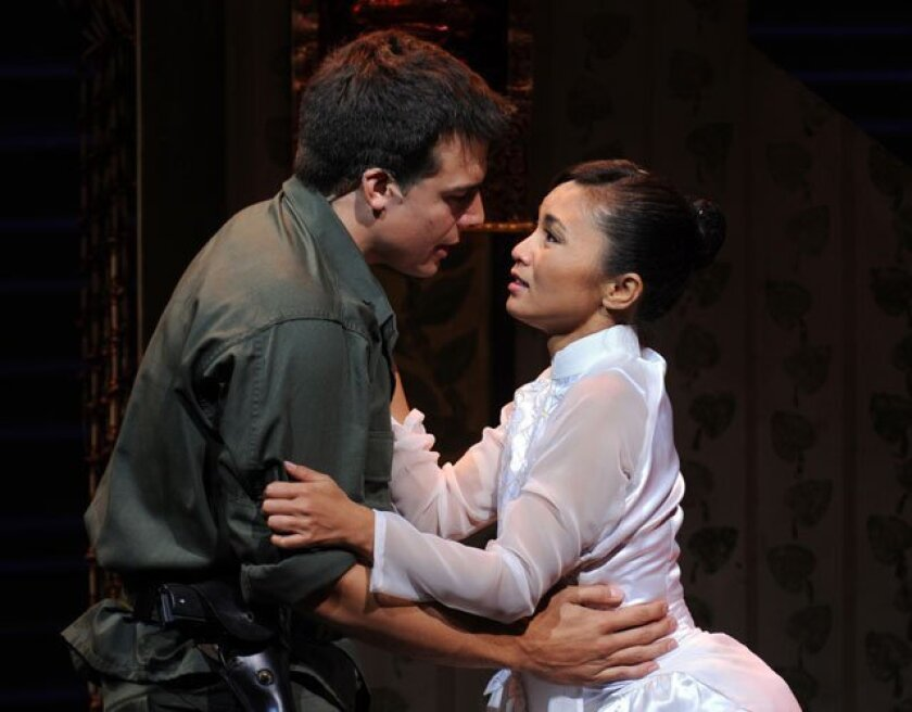 "Douglas Carpenter as Chris and Jennifer Paz as Kim in Moonlight's ""Miss Saigon."""