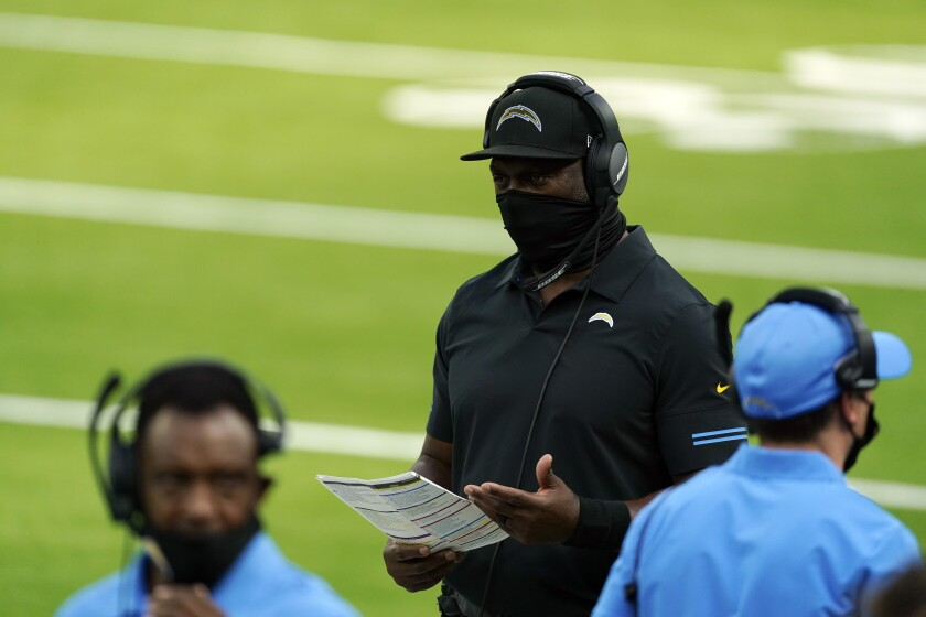 Chargers head coach Anthony Lynn walks on the sideline during Sunday's game against Kansas City in Inglewood.