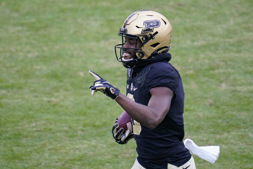 Purdue wide receiver David Bell (3) runs in for an 89-yard touchdown after a catch against Nebraska during the fourth quarter of an NCAA college football game in West Lafayette, Ind., Saturday, Dec. 5, 2020. (AP Photo/Michael Conroy)