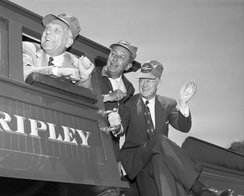 July 17, 1955:  California Gov. Goodwin Knight, left, Walt Disney and Fred G. Gurley, president of Santa Fe Railroad, on Disneyland's invitation-only opening day.