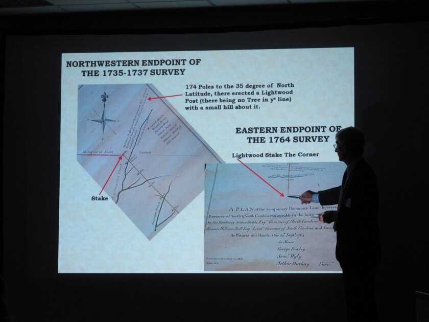 FILE- In this March 23, 2012 file photo, surveyor Alan-Jon Zupan shows a copy of an 18th century survey used to find the North Carolina-South Carolina state line in his presentation to the Joint Boundary Commission in Rock Hill, S.C. More than 50 families and businesses could find themselves living