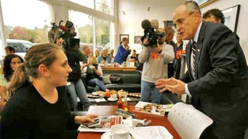 AT THE CORE: Concern over security could lead Christian conservatives to overlook disagreements with Rudolph Giuliani, above, at a campaign stop in a Kirkland, Wash., cafe last month.
