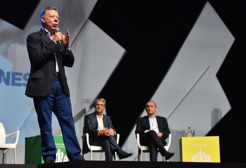 """El presidente de Colombia, Juan Manuel Santos, habla durante el """"Tercer encuentro de jóvenes de la Alianza del Pacífico"""" hoy, viernes 29 de junio de 2018, en Cali (Colombia). EFE"""