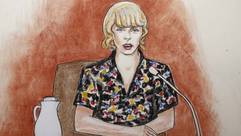 In this courtroom sketch, pop singer Taylor Swift speaks from the witness stand during a trial Thurs