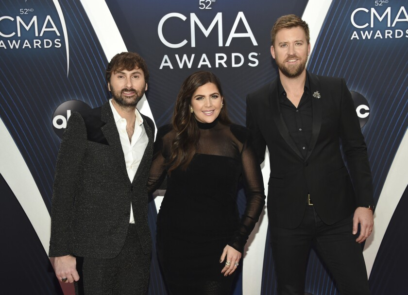 Dave Haywood, left, Hillary Scott and Charles Kelley recently changed their band's name from Lady Antebellum to Lady A.