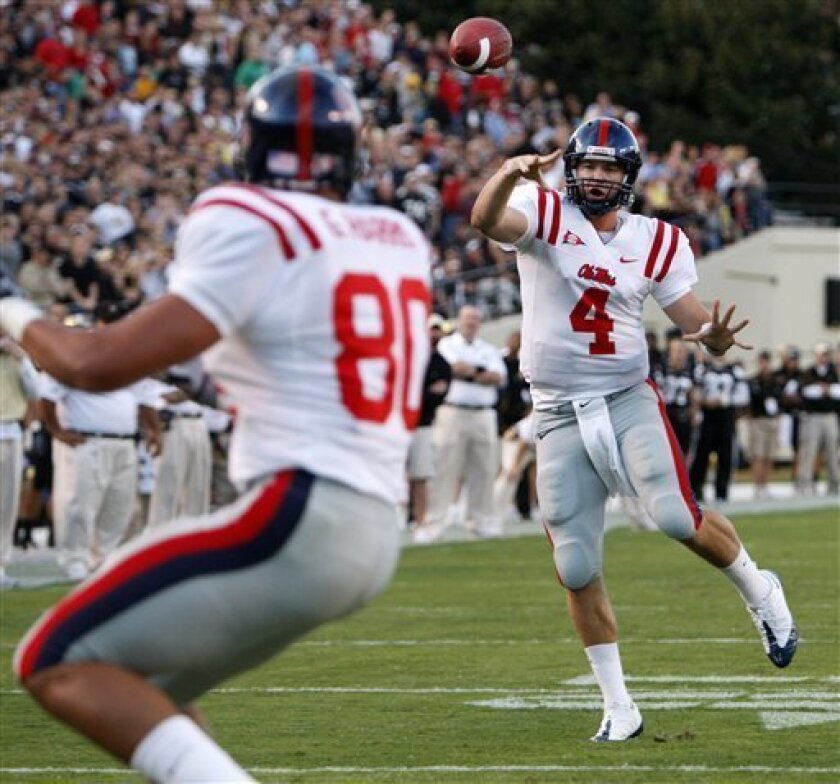 Mississippi quarterback Jevan Snead (4) passes to tight end Gerald Harris (80) in the first quarter of an NCAA college football game against Vanderbilt in Nashville, Tenn., Saturday, Oct. 3, 2009. Harris dropped the pass in the end zone. (AP Photo/Mark Humphrey)