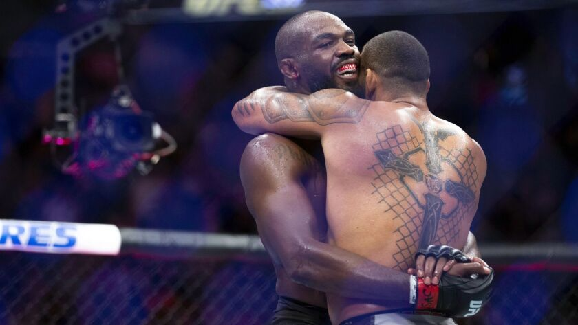 Jon Jones, left, and Thiago Santos, embrace after their light heavyweight mixed martial arts title b